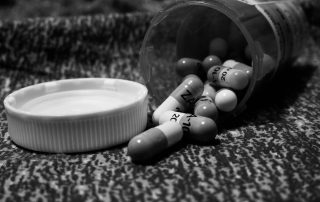grayscale image of a pill bottle