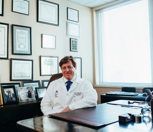 A doctor at his desk