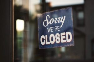 "A ""Sorry, We're Closed"" Sign on a door"